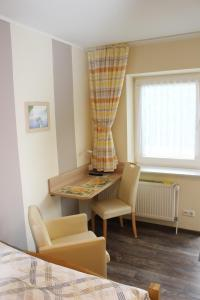 A seating area at Jahnkes Gasthaus-Pension garni