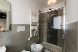 Um banheiro em Hotel Paganelli