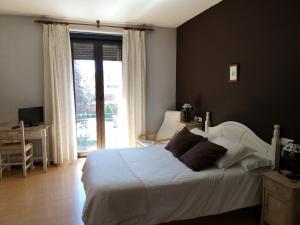 Cama o camas de una habitación en Hostal San Martin