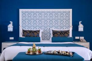 A bed or beds in a room at Radisson Blu Resort & Thalasso Hammamet