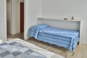 A bed or beds in a room at Casa Comisso