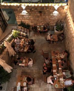 A restaurant or other place to eat at Ćiri Biri Bela boutique hostel