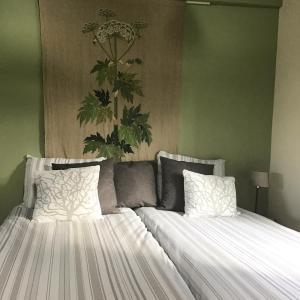 Ein Bett oder Betten in einem Zimmer der Unterkunft Het Bijhuisje