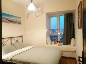 Een bed of bedden in een kamer bij Chengdu Inn (Jinli Street branch)