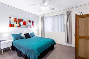 A bed or beds in a room at Penthouse with Waterviews
