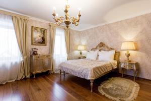 Кровать или кровати в номере Арт Отель Николаевский Посад