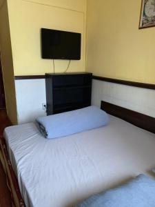 Кровать или кровати в номере Гостиница Сиреневая