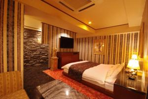 ホテル アヴァ(大人専用)にあるベッド