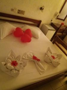 A bed or beds in a room at Melpo Hotel