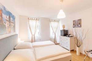 Ein Bett oder Betten in einem Zimmer der Unterkunft Hotel Markgraf Leipzig