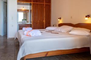 Ένα ή περισσότερα κρεβάτια σε δωμάτιο στο Naftis Apartments
