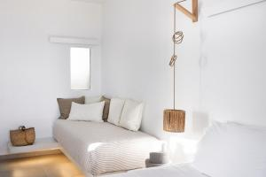 A bed or beds in a room at Gerofinikas Boutique Hotel
