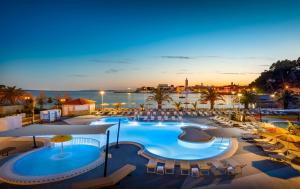 A view of the pool at Valamar Padova Hotel or nearby