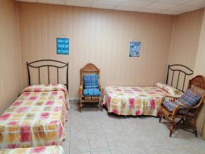 A bed or beds in a room at Albergue de Peregrinos A Santiago