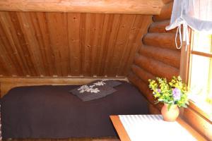 Säng eller sängar i ett rum på Forest Cottage