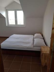 Posteľ alebo postele v izbe v ubytovaní Apartmány Horná Seč
