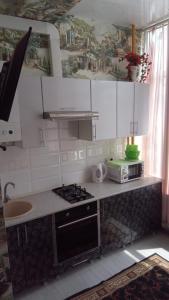 A kitchen or kitchenette at Apartment Krymskaya 22/22