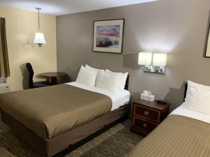 A bed or beds in a room at Americas Best Value Inn Scarborough Portland