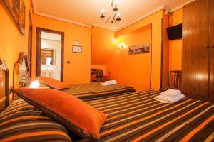 Cama o camas de una habitación en CASA RURAL BARAZAR