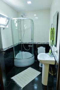 A bathroom at Friendly Guest House
