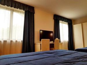 Letto o letti in una camera di Il Grifo Hotel e Bisteccheria Toscana