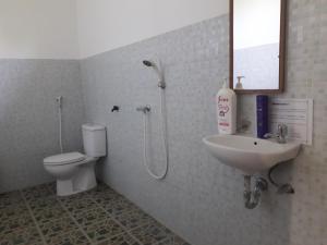 Salle de bains dans l'établissement Rani Homestay
