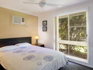 A bed or beds in a room at Three Bedroom Home plus Pool