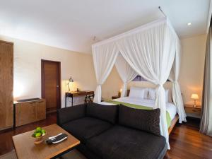 A bed or beds in a room at The Samata