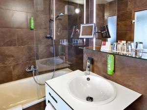 Ein Badezimmer in der Unterkunft Austria Trend Hotel beim Theresianum Wien
