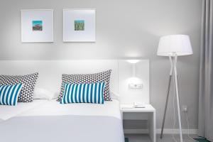 Cama o camas de una habitación en Hotel Blue Sea Interpalace