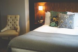 A bed or beds in a room at The Mill at Conder Green
