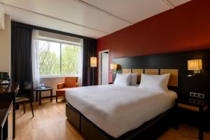 A bed or beds in a room at The President Brussels Hotel