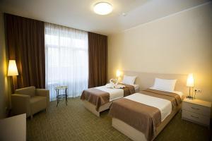 Кровать или кровати в номере  Крона Отель и СПА