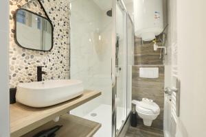 A bathroom at Résidence Bonne Nouvelle