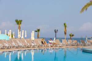The swimming pool at or near Leonardo Laura Beach & Splash Resort