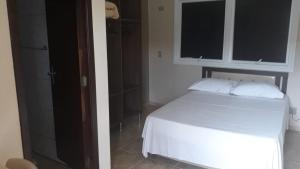 A bed or beds in a room at Hotel Maringa
