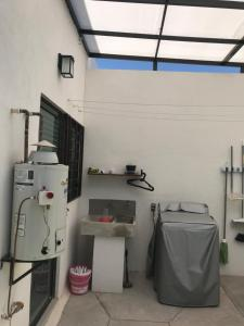 A kitchen or kitchenette at Vive San Luis Potosí, Zona Industrial