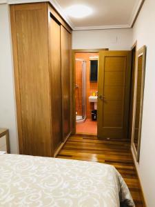 Cama o camas de una habitación en Apartamentos San Froilan