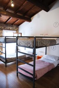 A bunk bed or bunk beds in a room at The Hostello