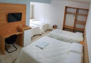 A bed or beds in a room at Hotel Imperador Caldas