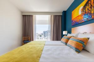Een bed of bedden in een kamer bij Luna Olympus
