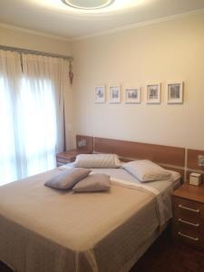 A bed or beds in a room at Apartamento FLAT LUXO c/Lareira + Vista Vale dos Vinhedos