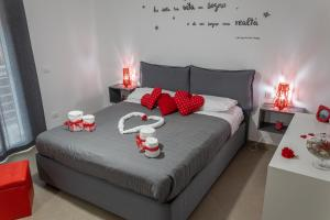A bed or beds in a room at Profumi del sud