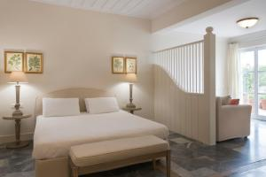 A bed or beds in a room at Dorion Hotel