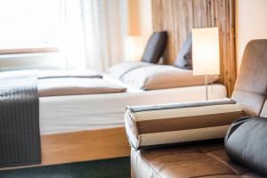 Letto o letti in una camera di Hotel BAMBOO Haupthaus