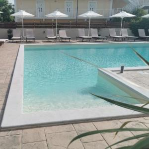 The swimming pool at or close to The Mathraki Studios (Adult Only)