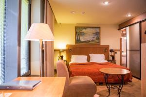 A bed or beds in a room at BEST WESTERN Santakos Hotel