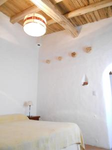 A bed or beds in a room at Hosteria Villa Cardon