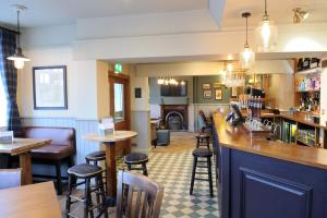 A restaurant or other place to eat at White Hart by Greene King Inns