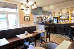 The lounge or bar area at White Hart by Greene King Inns